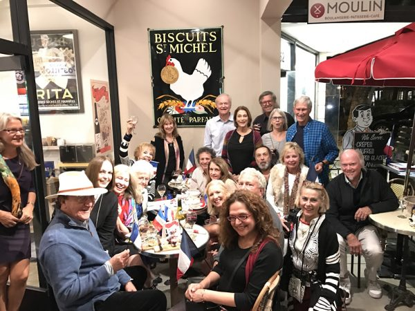 Sister City Association members toast the new beaujolais nouveau