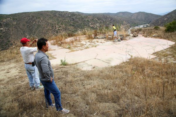 Randy Song, along with his father and sons, at their envisioned homesite overlooking Laguna Canyon, purchased this week at a steep price for open space. Photo by Jody Tiongco.