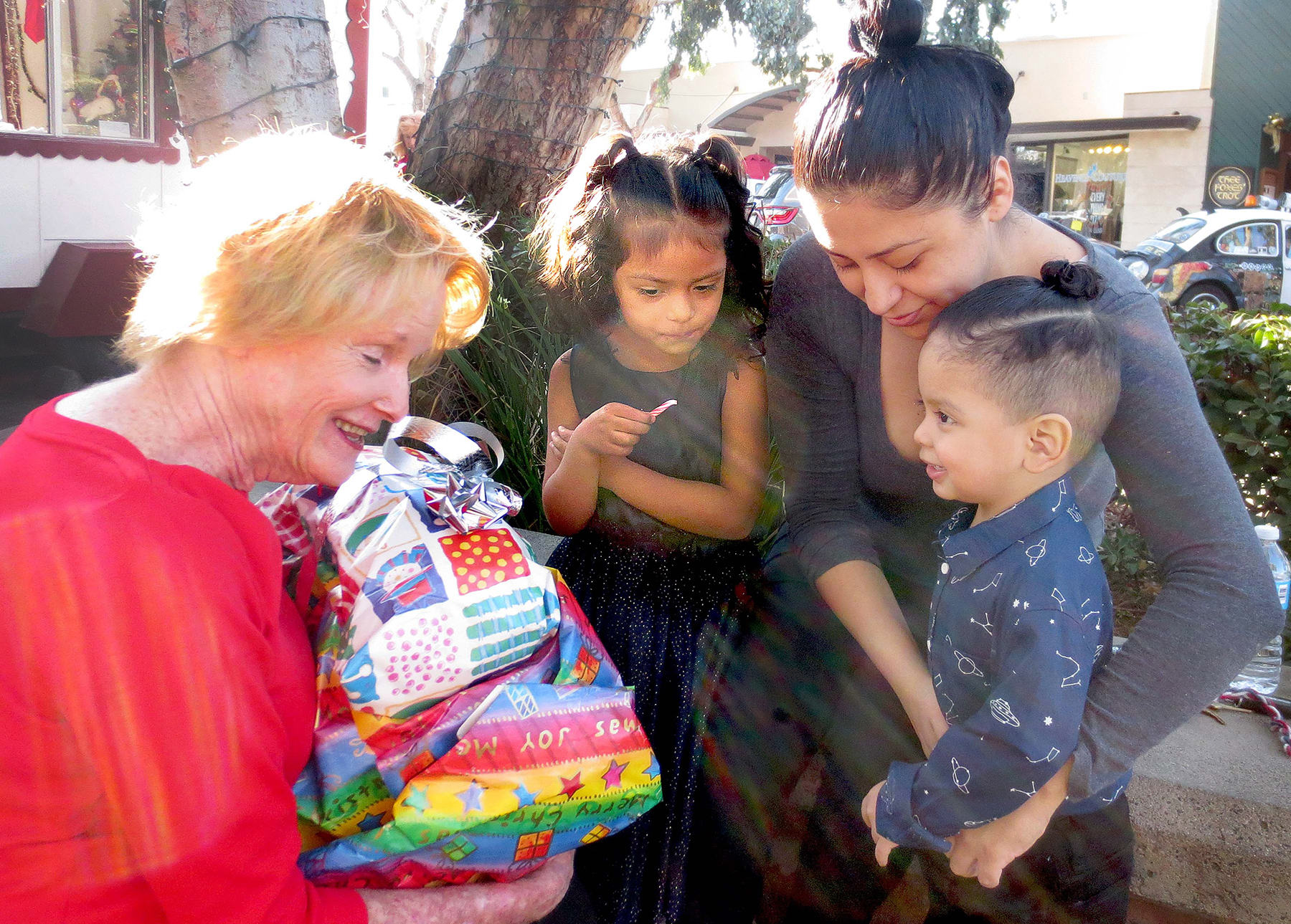 Chris Loidolt, Left, Brings Gifts To Maggie Ladislao Ramirez,22, And Her