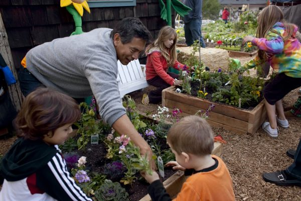 Horticulturist Ruben Flores demonstrates proper green-thumb technique.
