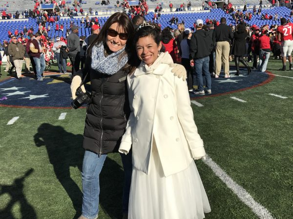 Moorea Howson, right, on the Liberty Bowl field last week with her mother, Kris.