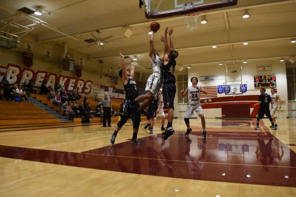 Laguna Beach High School varsity basketball player Adam Armstrong in action against Calvary Chapel, a 54-43 home victory Wednesday, Jan. 11. Photo courtesty of LB Basketball boosters.