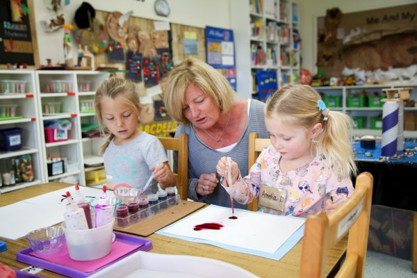 Children at Laguna Presbyterian preschool use eyedroppers as part of art and science projects to better develop fine motor skills, an area identified as a weakness among kindergartners in Laguna Beach public schools. Photo by Jody Tiongco.