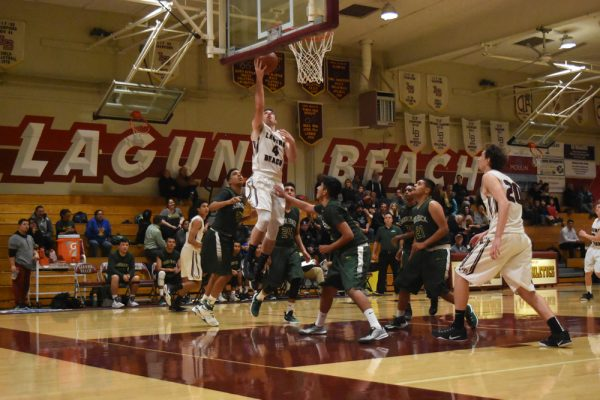 Grady Morgan goes up for two points for the Breakers against Saddleback on Wednesday, Jan. 25. Photo courtesy of  LBHS Boosters.