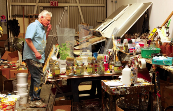 Father Bill Moore at work in his studio.