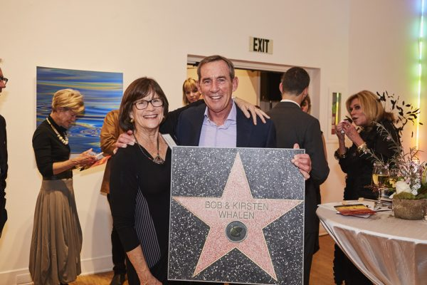 . Kirsten and Bob Whalen take home a special auction memento. Members of the event and host committee earned their own star on walk of fame, temporarily installed at the museum.