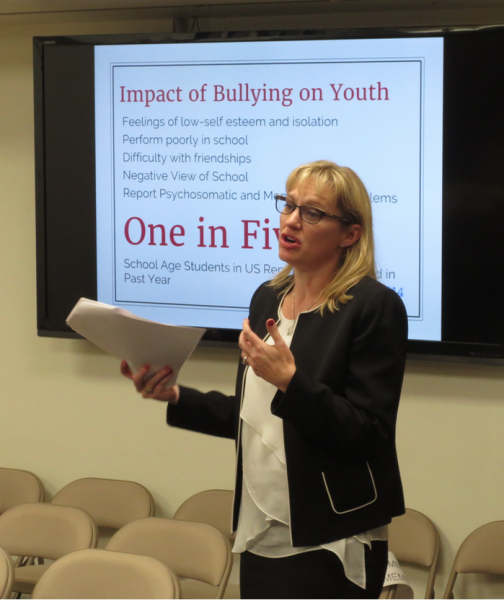 Administrator Alysia Odipo discusses student connectedness and school climate in preventing bullying at the school board meeting Tuesday, Feb. 14.