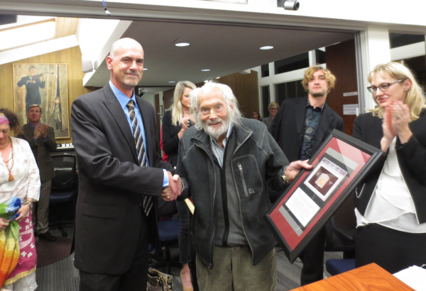 The school board and Principal Christopher Herzfeld recognize Bruce Hopping, 95, with an award for his advocacy in the visual and performing arts at the Tuesday, Feb. 14, meeting. Photos by Marilynn Young.