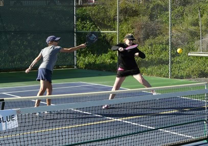 Players on a Laguna Woods pickleball court.