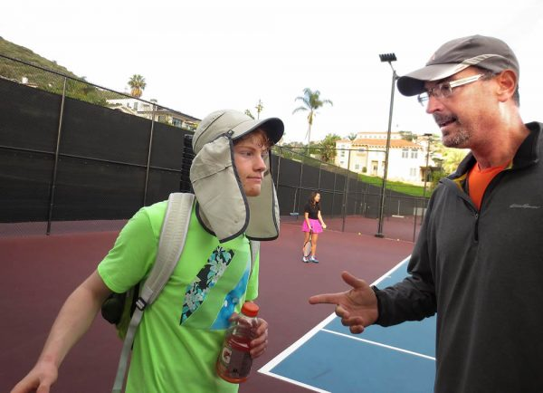 New LBHS tennis coach Rick Conkey gives Kyle Herkins, 15, a pointer after a recent practice.  Photo by Marilynn Young.