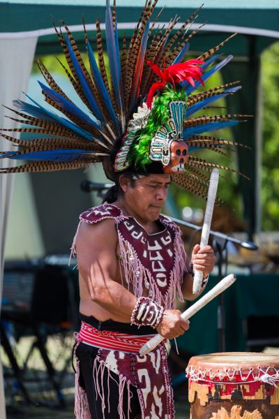 A drummer demonstrates his skill and flair at a previous public ceremony. Photo by Bram Norman.