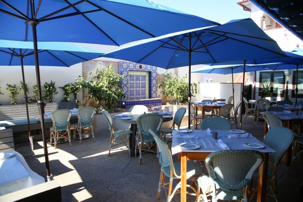 St. Clair designed Taverna includes a historic mural on its outside patio.