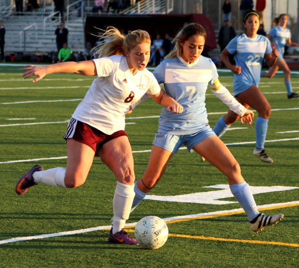 Laguna's Greer Jacobs battles for the ball against Bloomington High in an unsuccessful playoff contest at home Friday, Feb. 24. Photo by Karen Anderson.