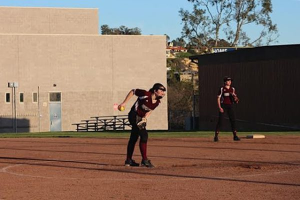 Emily Thomas winds up for a pitch as first base player Lola Fisher stands at the ready in the 14-0 against Dominguez played at Thurston Middle School Friday, March 3. Photo by Lisa Pitz