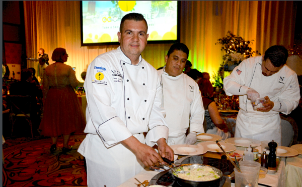 Chef Omar Gonzalez serves up truffle risotto with poached asparagus, shaved black truffles and aged parmesan crisps.