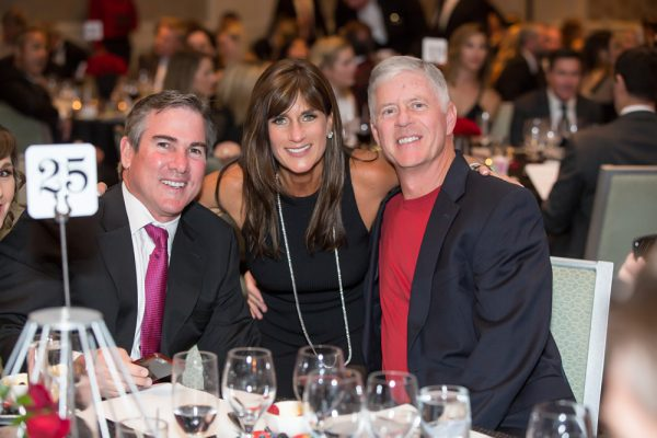Guests Tom Addis, Holly Wilson, and Jerry Hayden attend Schoolpower's dinner dance last month.