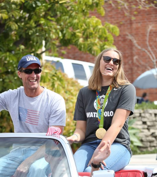 Grand Marshal and Olympic gold medalist Aria Fischer is accompanied by her dad, Erich, also an Olympic water polo competitor.