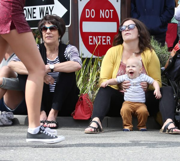 Even the youngest parade-goers show their enthusiasm for the 51st Patriot's Day Parade. Photo by Mike Altishin