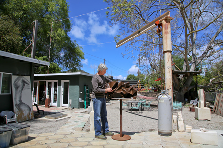 Sculptor Louis Longi at work in his Laguna Canyon property, which he still hopes to develop as live-work space for artists.