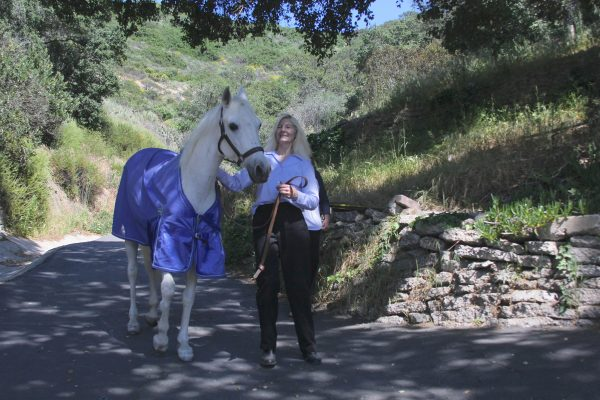 Sharon Dugan with her horse, which escaped Sunday and ran into traffic. Photo by andrea Adelson.