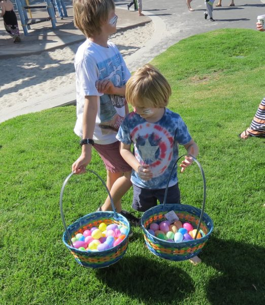 Luke Roselli checks out his brother Jack's haul at last year's Easter Egg Hunt in Lang Park. This year, the Methodist Church hosts a hunt at 10 a.m. and noon on Saturday, April 15, the day before Easter.