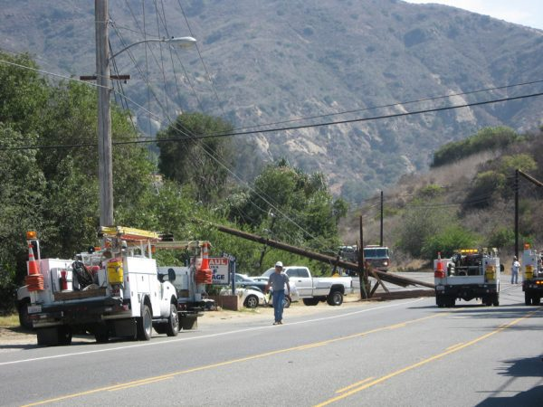 City officials continue to press utilities to underground their overhead lines, which routinely are pulled down to block and congest Laguna Canyon and spark occasional fires. Photo courtesy of the city of Laguna Beach.