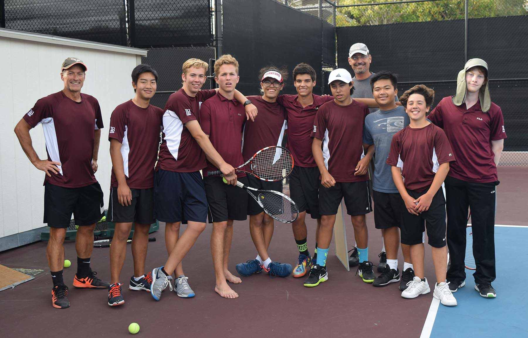 Laguna Beach boys tennis team with head coach Rick Conkey in the back and assistant coach Nicolis Radisay , left, completed their league Tuesday April 25, with an 8-0 record defeating all teams in the league. They head to CIF play-offs next week. Photo by Marilynn Young