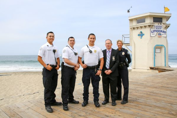 To combat rowdy behavior on South Laguna beaches, Police Chief Laura Farienella, right, is expanding beach patrol, from left, Tanner Flagstad, Aureliano Becerra, and Rod Goodwin. With them is civilian supervisor Jim Beres.  by Jody Tiongco.