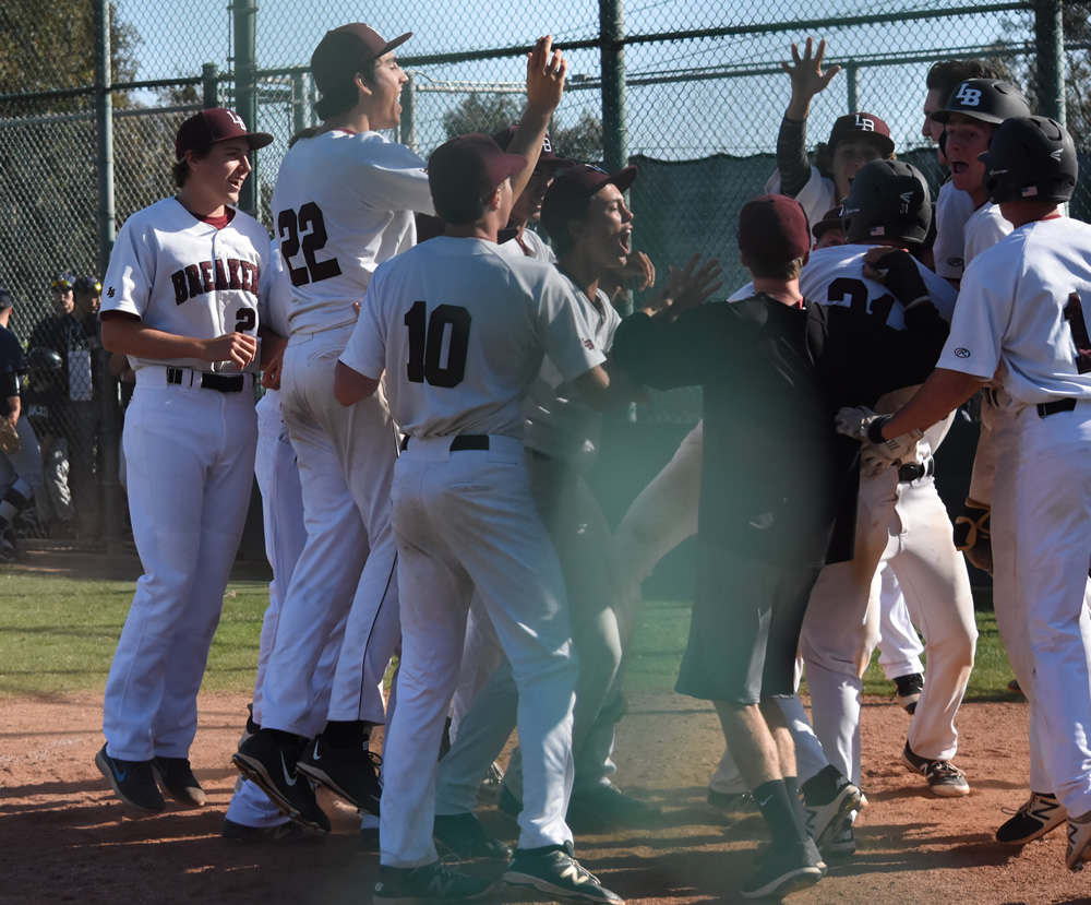Team celebrates at home plate after Grady Morgan's walk off homerun Wednesday, April 19, against Calvary Chapel.