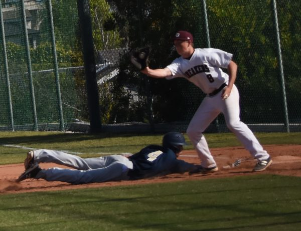 Cutter Clawson snags the pickoff throw at first base Wednesday, April 19, against Calvary Chapel.
