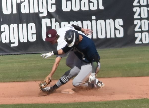 Conner Coscino attempts a tag on Calvary Chapel base runner Wednesday, April 19.