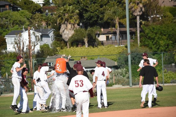 Grady Morgan gets Gatorade bath from teammates Will Bonn and Dylan Smith, Wednesday, April 19, against Calvary Chapel.
