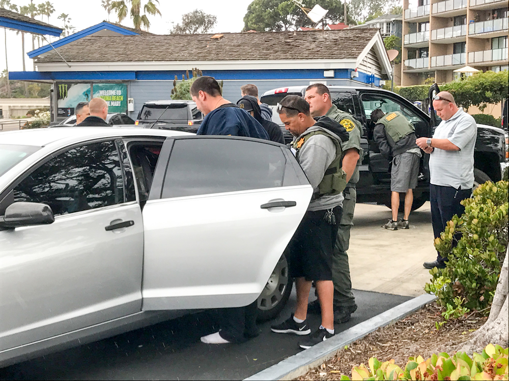 Sheriff's deputies and the CHP followed a vehicle stolen in Riverside along Laguna Canyon into Laguna Beach. A witness said congestion at the dead-end of Broadway helped end the pursuit. The driver was taken into custody without incident, police said. Phot by Jody Tiongco.