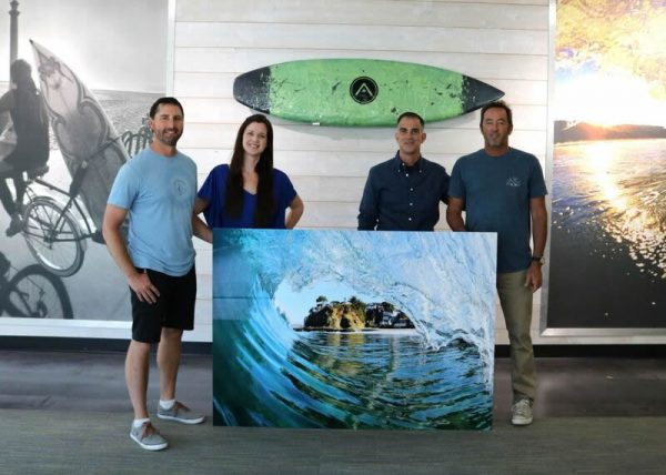 Sean Hunter, left, with one of his images purchased by Arbitech.