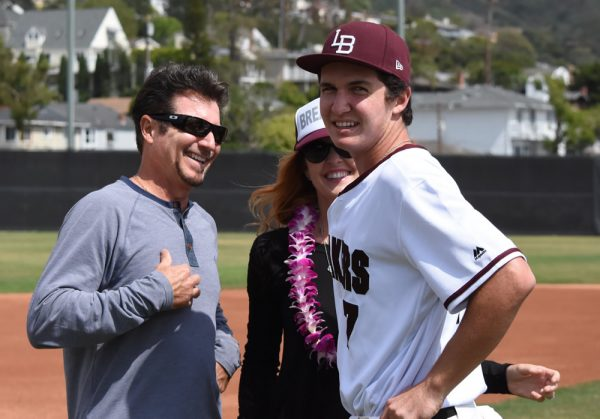 layer Dante Faicchio, who broke the season's double records, receives the well wishes of his parents, Nick and Diana.  photo courtesy of LBHS Baseball Boosters.