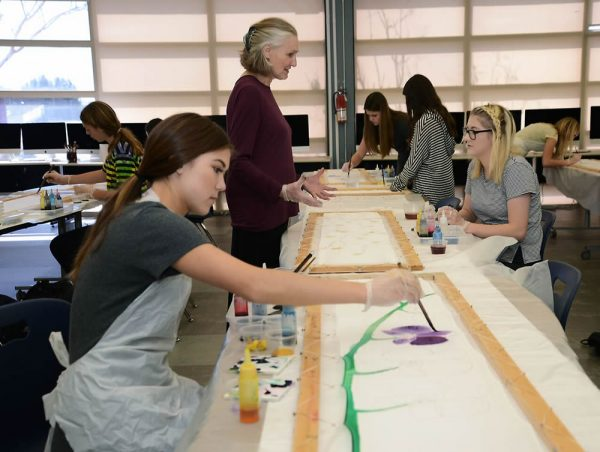 Local fabric artists Olivia Bathelder offers instruction to LBHS student artists. Photo by Adrienne Helitzer.