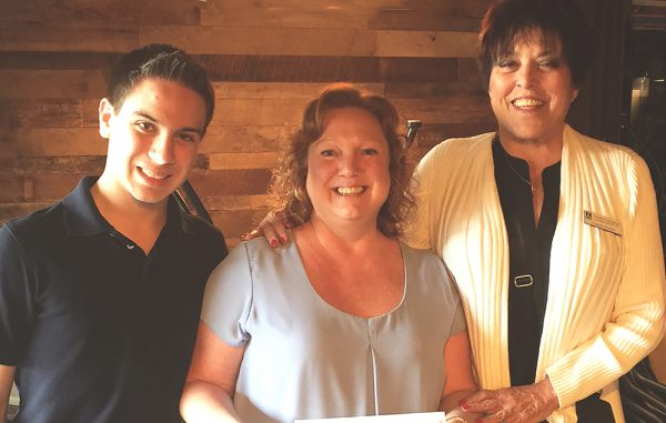 From left, Macguire and Stacy Brand, and Connie Burlin.