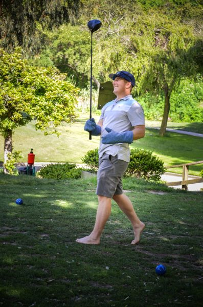 Oven mitts and bare feet didn't handicap the winner of the longest drive, Jeff Regal. Photos by Blue sky's Studio.
