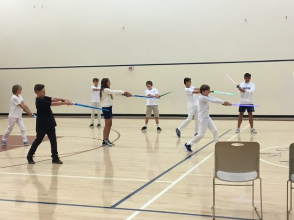 "St. Catherine students perform in a ""Star Wars"" themed tribute to Mozart, the musician they've studied through a Pacific Symphony enrichment program. Photo by Tracy Smith."