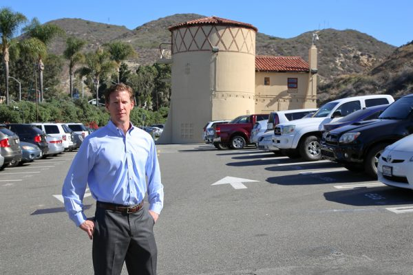Former city official Ben Siegel in the parking lot surrounding the historic digester, the focus of a proposed landscape makeover approved this week by the City Council. Photo by Jody Tiongco.