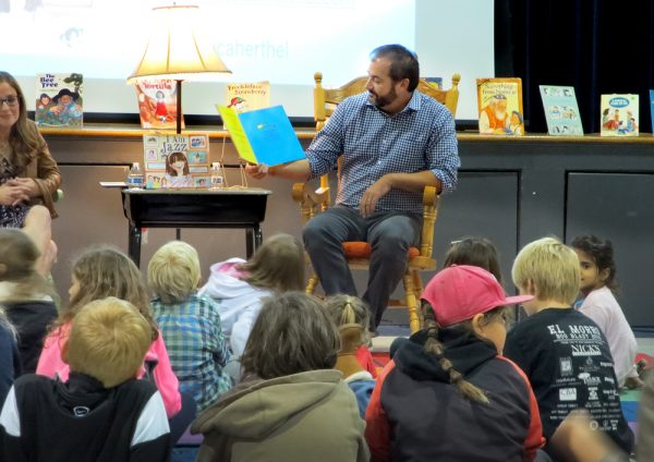 Chris Tebbutt's efforts for official recognition of LGBT contributions to the community resulted in a City Council designation this week. Here, Tebbutt at a children's literature reading about family diversity at El Morro Elementary last December. Photo by Marilynn Young.