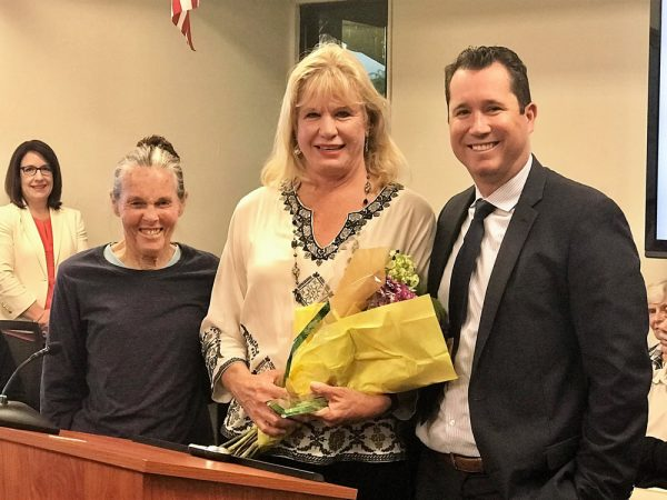 Retiring instructional assistant Eleanor Tiner is flanked by board President Jan Vickers and Supt. Jason Viloria.