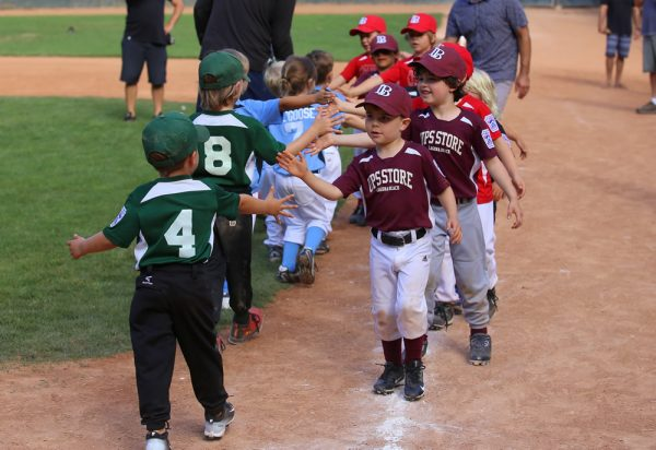Little League T-ballers high-five after exhibition game.Courtesy of Scott Brashier, StuNewsLaguna.