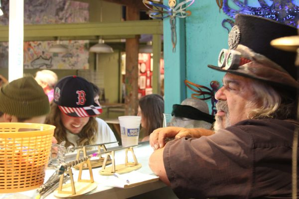 Dr. Neon, right, confers with a customer at The Sorcerer's Apprentice booth.Photo by andrea Adelson.