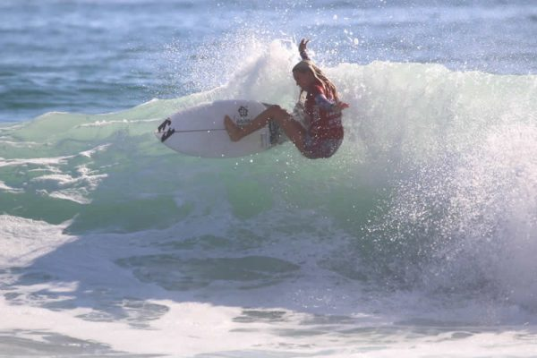 Kayla Coscino, of Laguna Beach, rides to a fifth-place finish in the national high school surf championship.