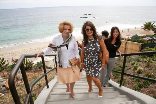 Mayor Toni Iseman, left, and Public Works Director Shohreh Dupuis are among the first to ascend the newly opened beach access stairs at Mountain Road. Photo by Jody Tiongco.