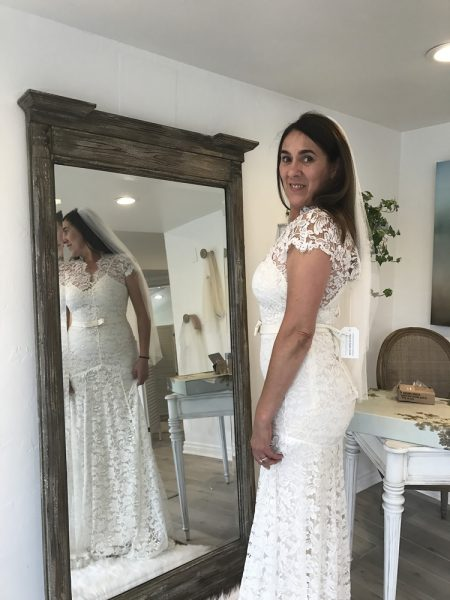 Owner Deborah Badillo wears one of her favorite gowns, similar to the one she wore on her wedding day. Photo by Rachel Katz.