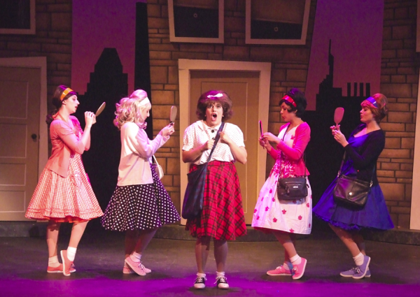 "Tracy Turnblad, center, embodied by Nicole Powell, is the lead character in the current Laguna Playhouse production, the musical ""Hairspray,"" which runs through July 30."