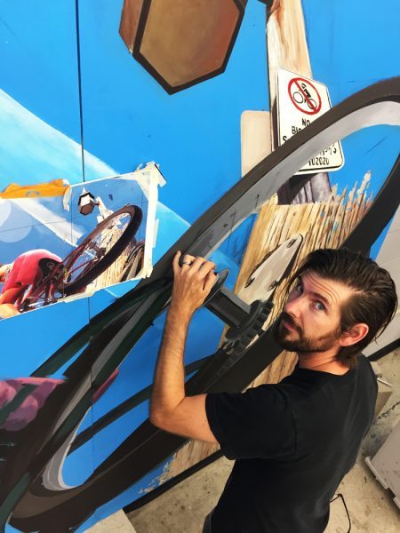 Artist Tim Robert Smith at work on one of the mural panels. Photo by Yuki Toy.