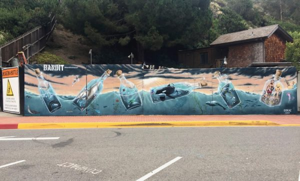 "The ""Message in a Bottle"" mural, finished a week before the Sawdust Festival opened for its summer show, illustrates pollution's impact in the ocean."